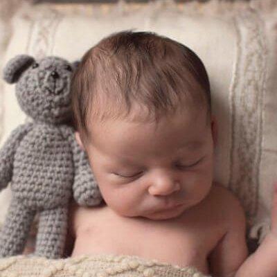 sleeping newborn with teddy