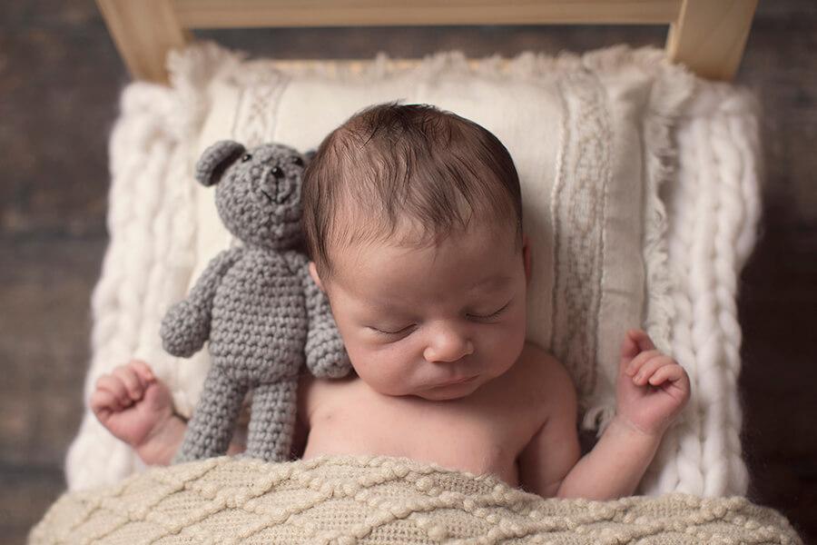 RI Newborn Photographer baby Dylan sleeping with crochet teddy bear