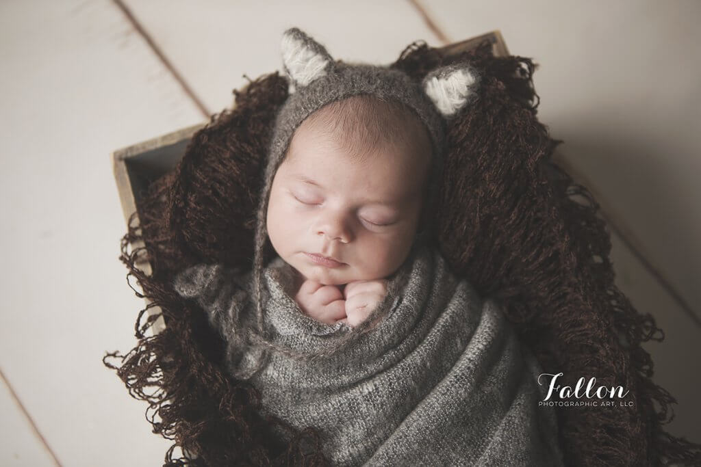 sweet newborn in crate